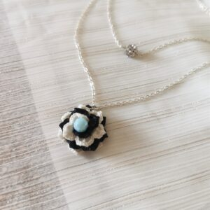 double layered necklace with white black crochet flower