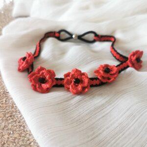 crochet headband with red flowers