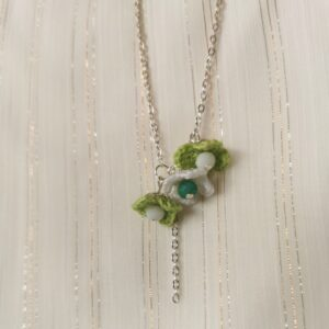 necklace with green and white crochet flowers
