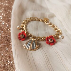 anklet with shell and red crochet flowers