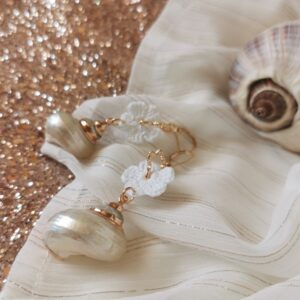 earrings with white crochet flowers and shells