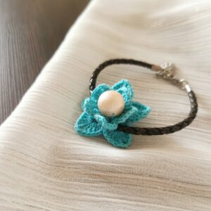 bracelet with blue crochet flower and genuine leather band