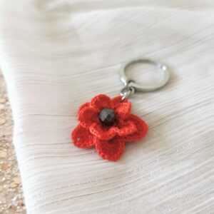 keychain with red crochet flower