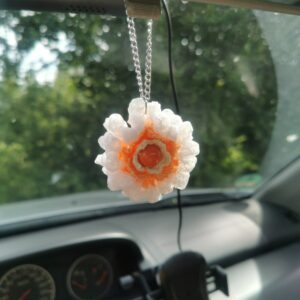 car mirror pendant with large orange crochet flower