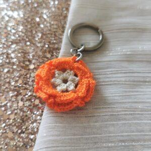 keychain with orange crochet flower