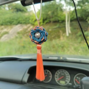car mirror hanging accessory with blue crochet flower and orange tassel