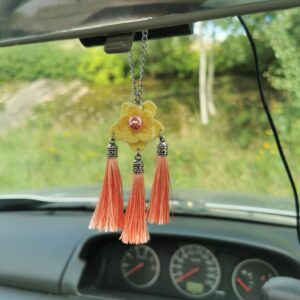 car mirror hanging accessory with yellow crochet flower and pink tassels