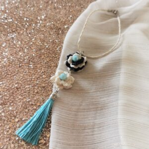 car pendant with crochet flowers and blue tassel