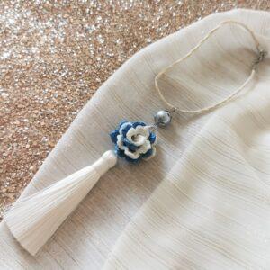 car pendant with white blue crochet flower and white tassel