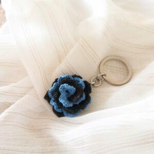 keychain with black blue crochet flower